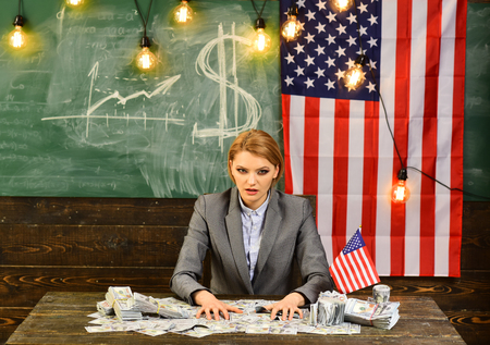 Economy and finance. economy of america with woman holding money at flag.
