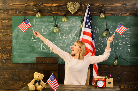 patriotism, national pride and independence day concept - happy girl in with american flag. Reklamní fotografie