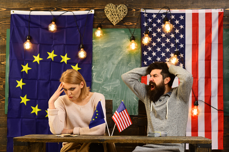 conflict between usa and european union. conflict of man and woman with flag of usa and eu. Stock fotó