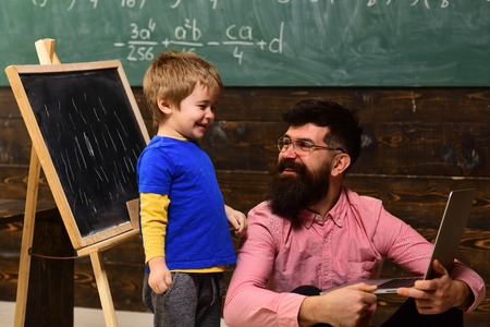 Tutor or teacher must be an energetic person. Student looks for studying method that suits his learning style. Studying mathematics educational background. Private coach in the class Stock Photo