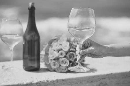 wedding celebration. Wedding bouquet bottle and wine glasses Reklamní fotografie