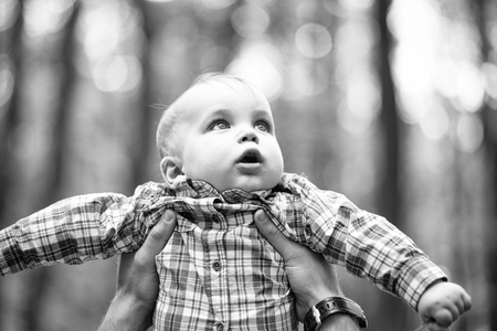 surprised small child. Little kid in father s hands Stock fotó