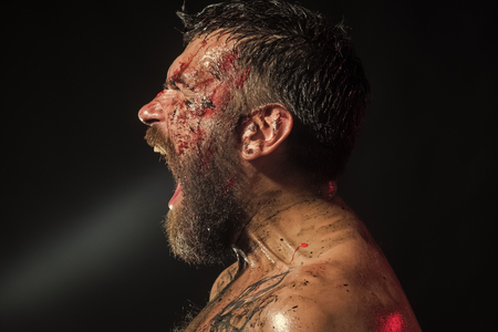 fury. Hipster shout with bloody beard on brutal face profile Stock Photo