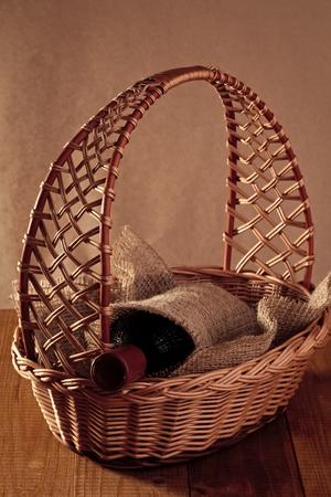 bottle of wine in a basket. Bottle of wine in basket