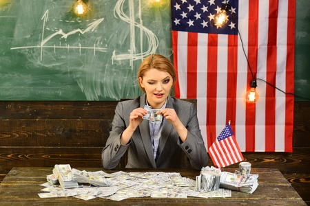 Income planning of budget increase policy. Economy and finance. Patriotism and freedom. American education reform at school in july 4th. Woman with dollar money for bribe. Independence day of usa Stock fotó