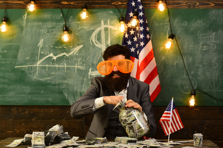Income planning of budget increase policy. Independence day of usa. Travel vacation concept. school in july 4. Economy and finance. Patriotism and freedom. Bearded man with dollar money for bribe