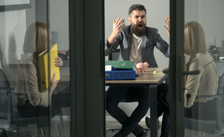 Angry irate boss yelling and shouting at secretary employee Imagens - 103485336