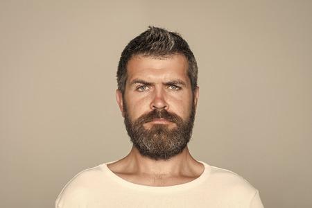 Feeling and emotions. Guy or bearded man on grey background. 版權商用圖片