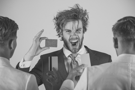 Banking and saving concept. Man shouting with excited face with blue card in hand