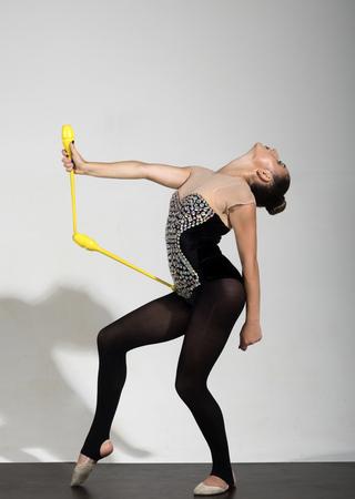 gymnastics and sport concept. gymnastics of girl with mace. Stock Photo