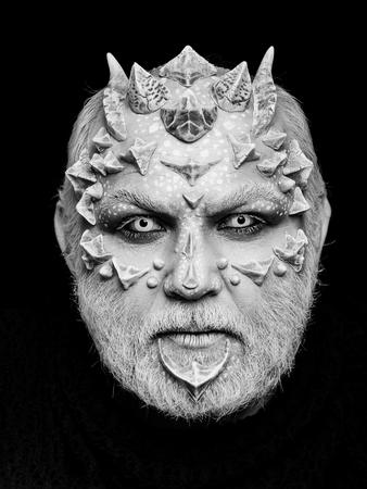Demon head on black background. Alien or reptilian makeup