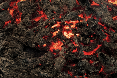 Magma textured molten rock surface. Lava flame on black ash background Фото со стока - 103765157