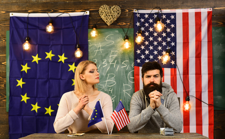 Economic partnership and finance. bearded man and woman politician at conference. contract negotiation and business regulation. foreign policy conflict. Partnership between usa and european union