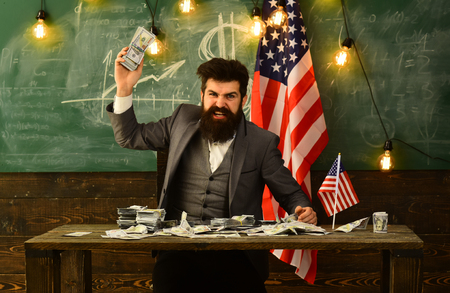 budget increase policy. budget of ameca with bearded man at flag. Stock fotó