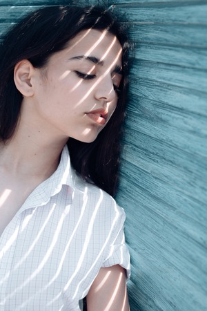 Beautiful dreamer. Arabian woman relax with closed eyes, pure look. Sensual woman with long hair. Skincare and freshness. Total relaxation and true bliss. Day dreaming and feeling calm Banque d'images - 103537452