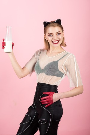 Cat woman hold milk bottle. cat woman with happy face drink milk,