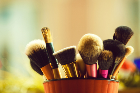 beauty, visage and design. fashion brush for fashionable makeup or cosmetic in pink cup