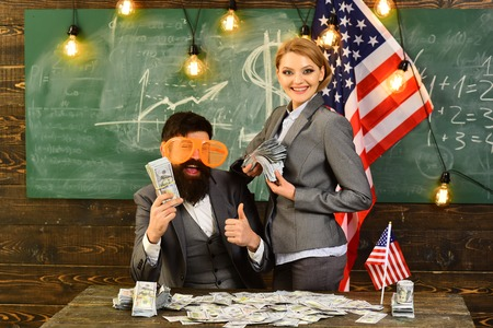 bearded man and woman with dollar money plan travel. Economy and finance. Independence day of usa. American education reform at school in july 4. Income of budget increase policy