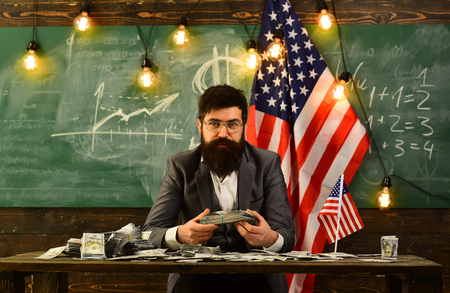 Economy and finance. Patriotism and freedom. Independence day of usa. American education reform at school in july 4. Income planning of budget increase policy. Bearded man with dollar money for bribe