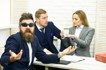 Business partners or businessman at meeting, office background. Business negotiations, discuss conditions of deal. Startup concept. Man with beard and glasses proposes extraordinary startup idea