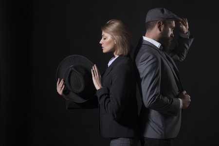 Fingerprinting to solve crimes. Old fashioned approach. Couple detective investigators partners. Partnership clever intelligent reporter investigator. Man and blonde lady dressed formal old fashioned