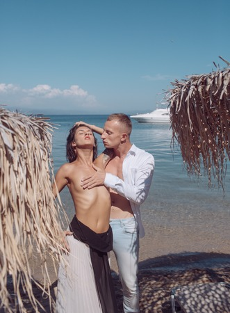 Love relations of naked couple at sea yacht. love and traveling concept. Stockfoto