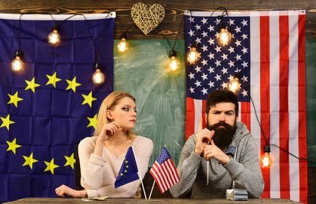 Economic partnership and finance. Partnership between usa and european union. bearded man and woman politician at conference. contract negotiation and business regulation. foreign policy conflict Фото со стока