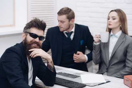 Business partners or businessman at meeting, office background. Business negotiations, discuss conditions of deal. Man with beard and glasses proposes extraordinary startup idea. Startup concept
