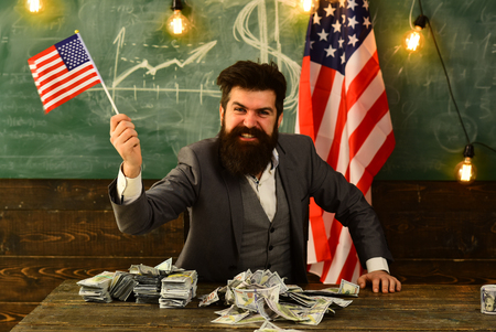 bearded businessman with american flag and money.
