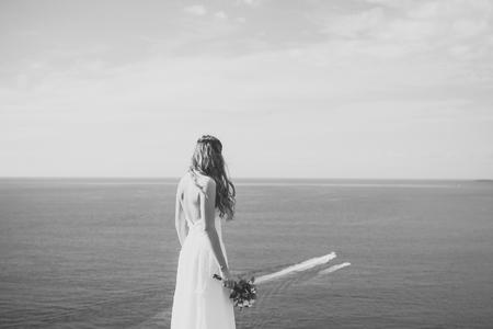 wedding ceremony. Pretty bride in white dress with wedding bouquet