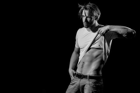 advertising mens underwear. Handsome man in white tshirt showing sexy, muscular torso Stock Photo
