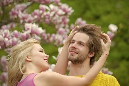 Sensual romantic couple. Sensual woman and man in magnolia bloom