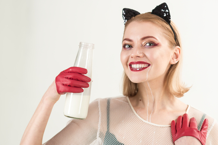 beautiful girl with make up of cat drink milk. Stock Photo - 103720566