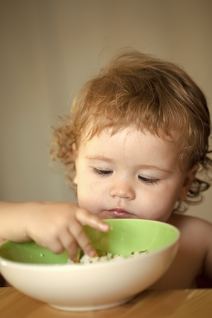 Child Childhood Children Happiness Concept. Portrait of small male kid eating