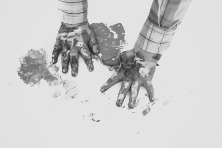 hand drawing. Child hands painted in colorful paints on white background