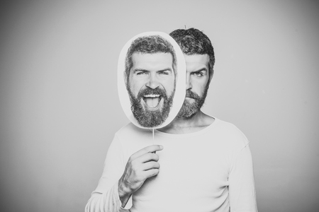 Beauty Fashion model man. Fashion look. Feeling and emotions. Guy or bearded man on grey background. Man with long beard and mustache. Barber fashion and beauty. 写真素材