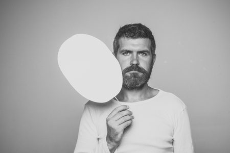 Beauty Fashion model man. Fashion look. Barber fashion and beauty. Feeling and emotions. Man with long beard and mustache. Hipster with serious face hold paper nameplate.