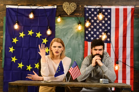 foreign policy conflict. contract negotiation and business regulation. Partnership between usa and european union. bearded man and woman politician at conference. Economic partnership and finance Фото со стока