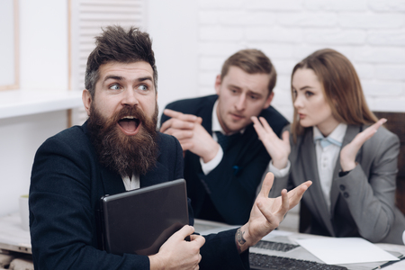 Business partners or businessman at meeting, office background. Startup concept. Man with beard and folder proposes extraordinary crazy startup idea. Business negotiations, discuss conditions of deal