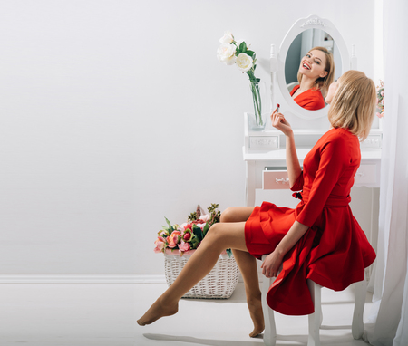 Beauty salon and fashion. beauty salon with woman in red dress, copy space