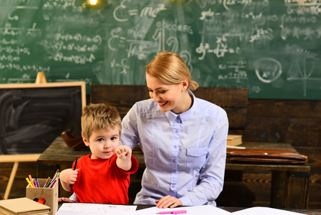 Student looks for studying method that suits his learning style, Modern teacher hipster writing on big blackboard with math formula, Some students learn best by listening