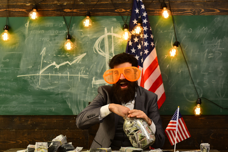 Economy and finance. Patriotism and freedom. Independence day of usa. Income planning of budget increase policy. Travel vacation concept. school in july 4. Bearded man with dollar money for bribe