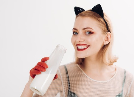 Young woman drinking milk like cat woman