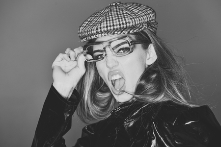 Fashion accessories. Sexy lady in stylish outfit, close up. Woman on scandalized face with make up wears checkered accessories and glasses for vision.