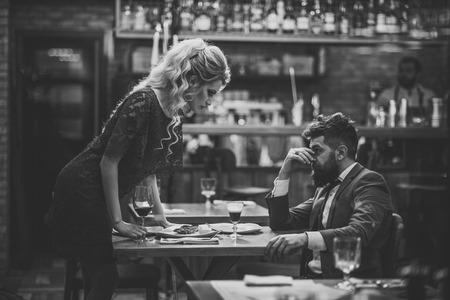 bad date.Young couple in restaurant having problems and crisis