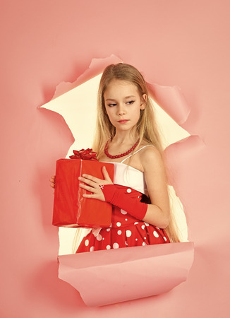children model. Child girl with present pack, cyber monday. child girl hold gift box, copy space