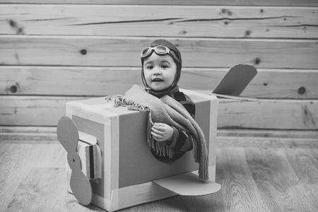 child pilot. Little dreamer boy playing with a cardboard airplane