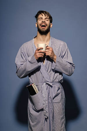 morning of a man. Bachelor in dressing gown smile with mug Stock Photo