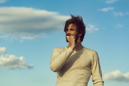 brush teeth. man brush teeth with toothpaste on blue sky, metrosexual