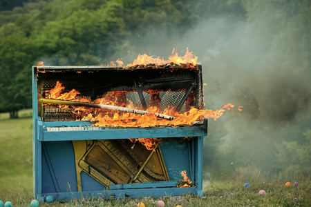 Burning piano. Grunge instrument, burning piano, musical style. grunge instrument of old piano on fire